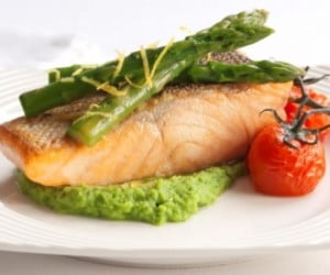 Oven baked ocean trout with roast vine ripened tomatoes and pea puree