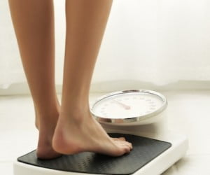 woman-stepping-bathroom-scale